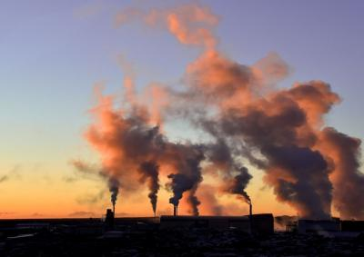 Emissions from smoke stacks and industry at sunrise